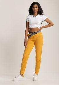 Renee - Żółte Spodnie Dresowe Salaphisha. Kolor: żółty. Materiał: dresówka