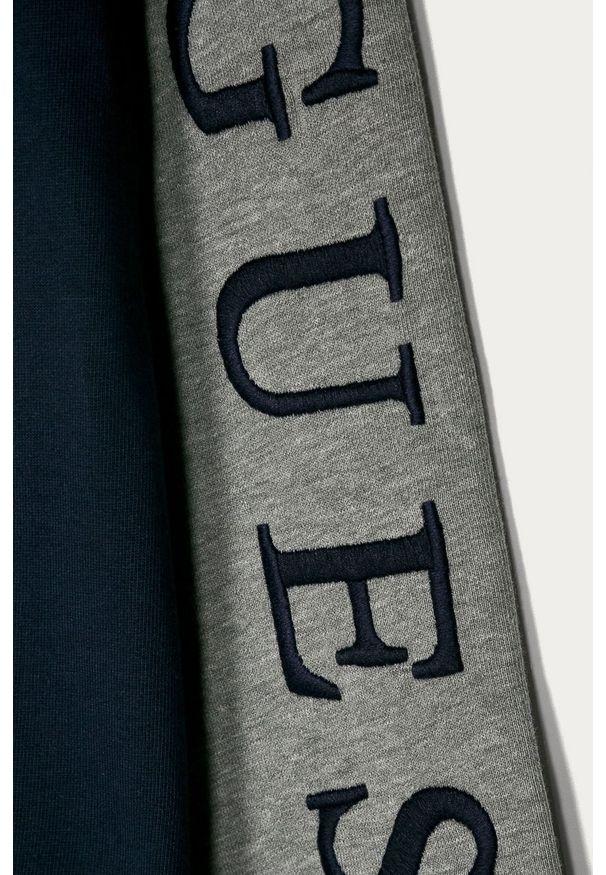 Niebieska bluza rozpinana Guess Jeans z aplikacjami, casualowa