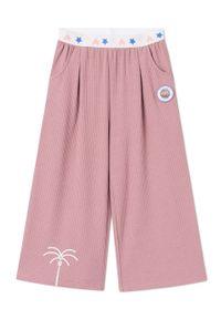 Różowe spodnie dresowe Femi Stories z aplikacjami