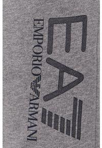 EA7 Emporio Armani - Spodnie. Kolor: szary. Wzór: nadruk