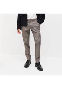 Brązowe spodnie Reserved