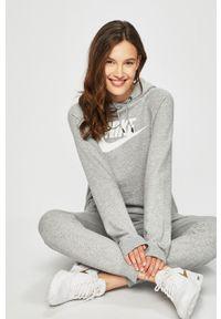 Nike Sportswear - Bluza. Okazja: na co dzień. Kolor: szary. Materiał: dzianina. Długość rękawa: raglanowy rękaw. Wzór: nadruk. Styl: casual