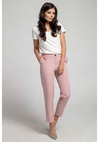 Różowe spodnie Nommo eleganckie