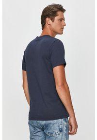 Niebieski t-shirt Tommy Jeans na co dzień, z okrągłym kołnierzem, casualowy