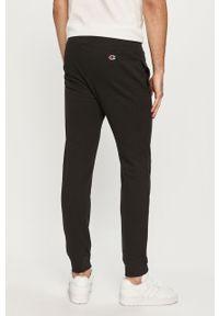 Czarne spodnie dresowe Champion z aplikacjami