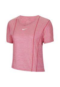 Koszulka treningowa damska Nike Icon Clash City Sleek CU3032. Materiał: dzianina, materiał, poliester. Technologia: Dri-Fit (Nike). Wzór: gładki. Sport: fitness