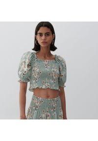 Reserved - Bawełniana bluzka w kwiaty - Wielobarwny. Materiał: bawełna. Wzór: kwiaty