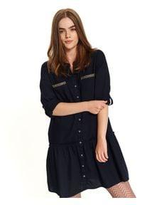 TOP SECRET - Sukienka z falbaną i aplikacjami. Okazja: na co dzień. Kolor: niebieski. Wzór: aplikacja. Sezon: zima, jesień. Typ sukienki: proste, koszulowe. Styl: elegancki, casual. Długość: mini