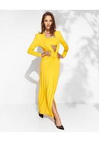 SIMONA CORSELLINI - Żółta sukienka z rozcięciem. Kolor: żółty. Materiał: wiskoza. Długość rękawa: długi rękaw. Typ sukienki: dopasowane. Styl: glamour. Długość: maxi