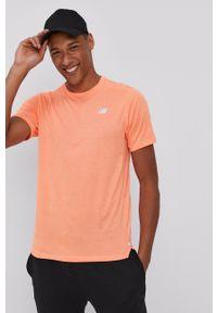 New Balance - T-shirt. Okazja: na co dzień. Kolor: pomarańczowy. Materiał: dzianina. Wzór: gładki. Styl: casual