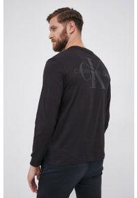 Calvin Klein Jeans - Longsleeve bawełniany. Kolor: czarny. Materiał: bawełna. Długość rękawa: długi rękaw. Wzór: nadruk