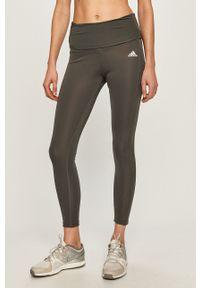 Adidas - adidas - Legginsy ciążowe. Kolekcja: moda ciążowa. Kolor: szary. Materiał: dzianina. Wzór: gładki
