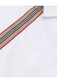 BURBERRY CHILDREN - Biała koszula z krótkim rękawem 3-12 lat. Okazja: na uczelnię, na co dzień. Kolor: biały. Materiał: bawełna. Długość rękawa: krótki rękaw. Długość: krótkie. Sezon: lato. Styl: wizytowy, casual, klasyczny