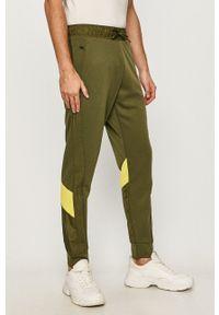adidas Performance - Spodnie. Okazja: na co dzień. Kolor: zielony. Styl: casual