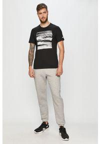 Szare spodnie dresowe Reebok