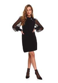 TOP SECRET - Sukienka z przezroczystymi rękawami. Okazja: do pracy, na imprezę. Kolor: czarny. Materiał: tiul, dzianina. Długość rękawa: długi rękaw. Sezon: zima. Styl: elegancki