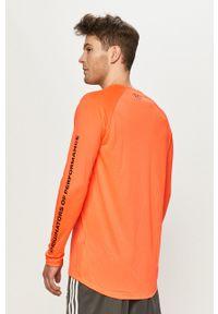Under Armour - Longsleeve. Okazja: na co dzień. Kolor: pomarańczowy. Długość rękawa: długi rękaw. Wzór: nadruk. Styl: casual