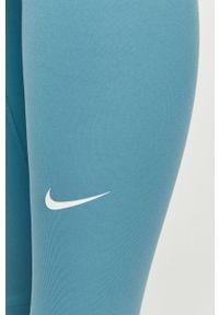 Nike - Legginsy. Stan: podwyższony. Kolor: niebieski. Materiał: włókno, skóra, tkanina. Technologia: Dri-Fit (Nike)