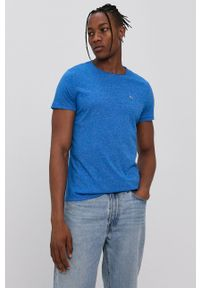 Tommy Jeans - T-shirt. Kolor: niebieski. Materiał: dzianina. Wzór: aplikacja
