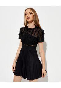 SELF PORTRAIT - Koronkowa sukienka z cekinami. Kolor: czarny. Materiał: koronka. Typ sukienki: plisowane, rozkloszowane. Styl: klasyczny. Długość: mini