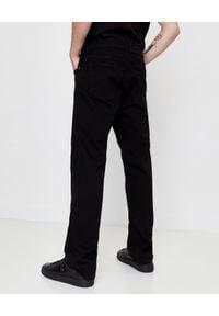 Versace Jeans Couture - VERSACE JEANS COUTURE - Czarne spodnie jeansowe. Okazja: na co dzień. Kolor: czarny. Styl: elegancki, casual