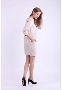 Beżowa sukienka wizytowa Nommo mini