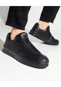 TOD'S - Czarne skórzane sneakersy. Nosek buta: okrągły. Kolor: czarny. Materiał: skóra