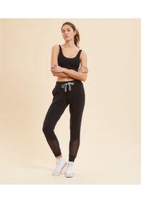 Czarne spodnie sportowe Etam na fitness i siłownię