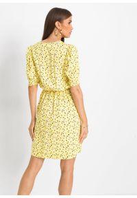 Sukienka z przyjaznej dla skóry wiskozy bonprix żółty ananasowy w kwiaty. Kolor: żółty. Materiał: wiskoza, skóra. Wzór: kwiaty