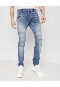 Balmain - BALMAIN - Niebieskie jeansy z haftowanym logo. Okazja: na co dzień. Kolor: niebieski. Wzór: haft. Styl: casual