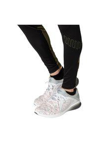 Spodnie męskie do biegania Asics Winter 2011B061. Materiał: tkanina, poliester, materiał, elastan. Długość: krótkie. Wzór: gładki. Sezon: jesień, zima. Sport: fitness