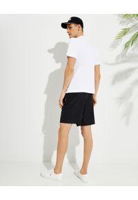 PALM ANGELS - Biały t-shirt z nadrukiem Boulevard. Kolor: biały. Materiał: bawełna. Wzór: nadruk. Styl: klasyczny
