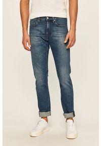 Niebieskie jeansy Calvin Klein z aplikacjami