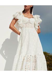 CHARO RUIZ IBIZA - Biała koronkowa sukienka Linda. Okazja: na imprezę. Typ kołnierza: kokarda. Kolor: biały. Materiał: koronka. Wzór: ażurowy. Sezon: lato. Styl: wakacyjny. Długość: maxi #2