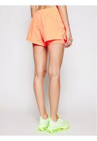 Pomarańczowe spodenki sportowe Nike