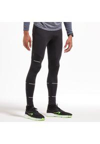 KIPRUN - Legginsy do biegania męskie Kiprun Dry. Materiał: poliester, poliamid, materiał, elastan. Sport: fitness