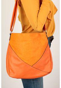 Pomarańczowa listonoszka Casu