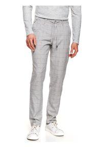TOP SECRET - Spodnie tkaninowe w kratę typu jogger. Okazja: do pracy, na co dzień. Kolor: szary. Materiał: tkanina. Długość: długie. Sezon: wiosna. Styl: casual #2