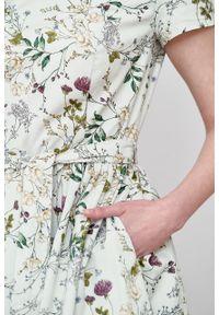 Marie Zélie - Sukienka Melia Ficiforma kremowa. Typ kołnierza: kokarda. Kolor: kremowy. Materiał: bawełna, skóra, materiał, elastan. Styl: klasyczny
