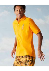 Lacoste - LACOSTE - Żółta koszulka polo z logo regular fit. Typ kołnierza: polo. Kolor: żółty. Materiał: bawełna. Wzór: prążki, haft, aplikacja