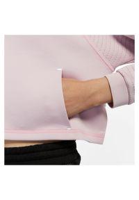 Bluza damska Nike Pro CU5745. Materiał: tkanina, poliester, materiał. Długość rękawa: raglanowy rękaw. Technologia: Dri-Fit (Nike). Długość: krótkie. Sport: fitness