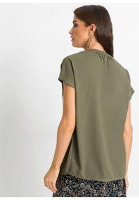 Bluzka bonprix oliwkowy. Typ kołnierza: dekolt w serek. Kolor: zielony