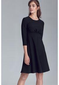 Nife - Czarna Rozkloszowana Sukienka Odcinana pod Biustem. Kolor: czarny. Materiał: elastan, wiskoza, poliester
