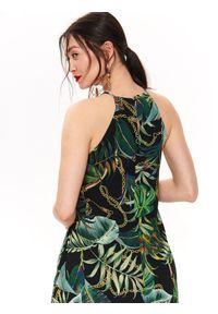 TOP SECRET - Sukienka damska w tropikalny wzór. Typ kołnierza: dekolt halter. Kolor: czarny. Materiał: materiał. Długość rękawa: krótki rękaw. Sezon: lato, wiosna. Styl: elegancki