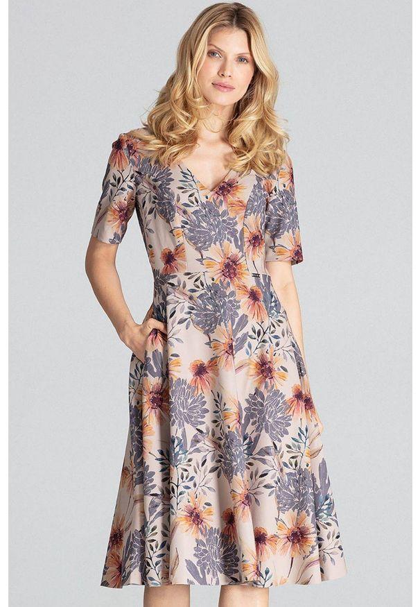 Figl - Rozkloszowana sukienka midi z dekoltem V w kwiaty. Okazja: do pracy, na imprezę. Wzór: kwiaty. Długość: midi