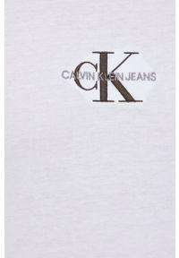 Calvin Klein Jeans - T-shirt bawełniany. Okazja: na co dzień. Kolor: biały. Materiał: bawełna. Wzór: aplikacja. Styl: casual