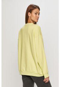 adidas Originals - Bluza. Kolor: żółty. Materiał: dzianina, poliester. Długość rękawa: długi rękaw. Długość: długie