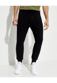 Versace Jeans Couture - VERSACE JEANS COUTURE - Czarne spodnie dresowe. Kolor: czarny. Materiał: dresówka