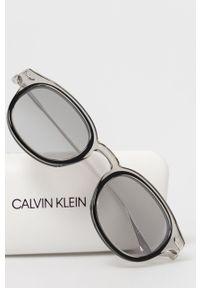 Calvin Klein - Okulary przeciwsłoneczne CK18701S.072. Kształt: okrągłe. Kolor: szary
