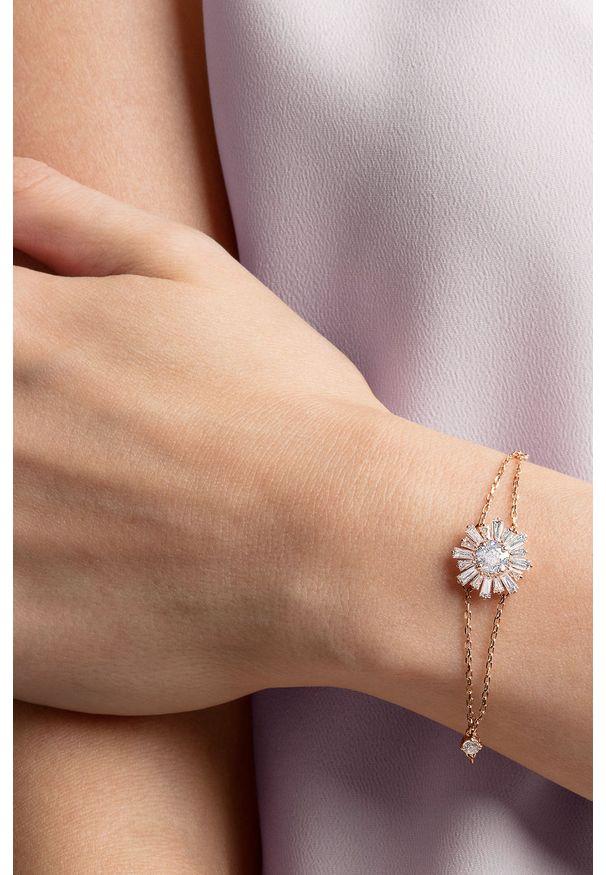Złota bransoletka Swarovski metalowa, z kryształem